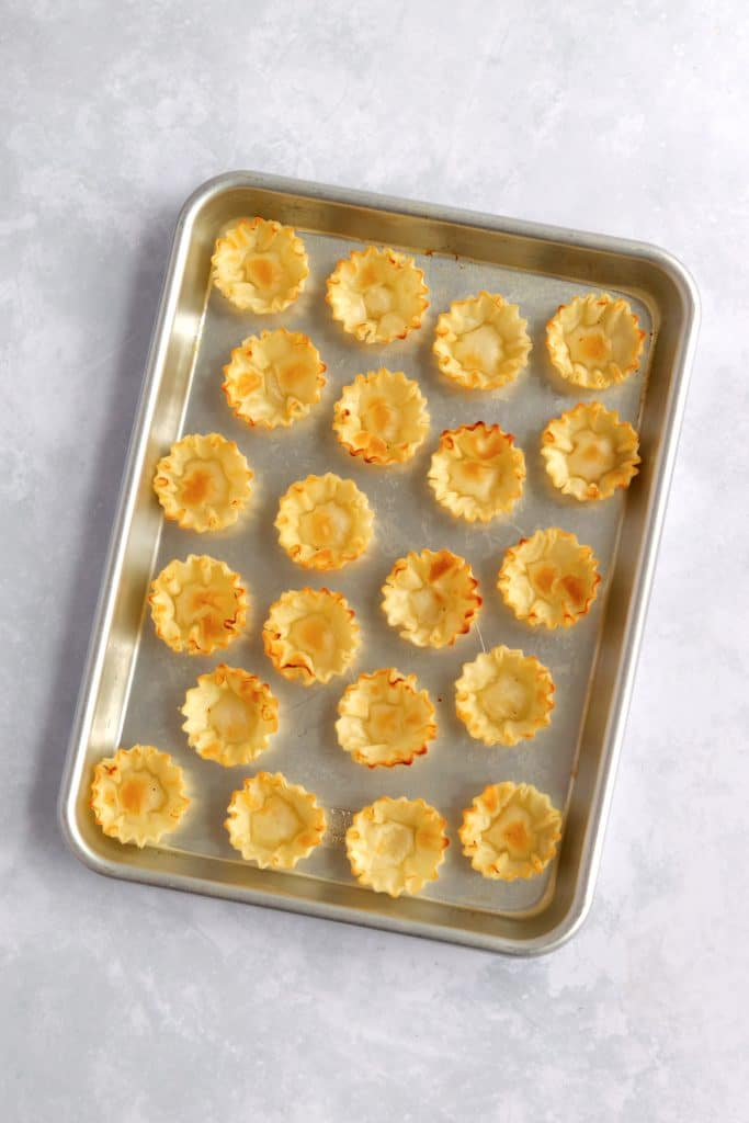 Baked phyllo cups on baking sheet