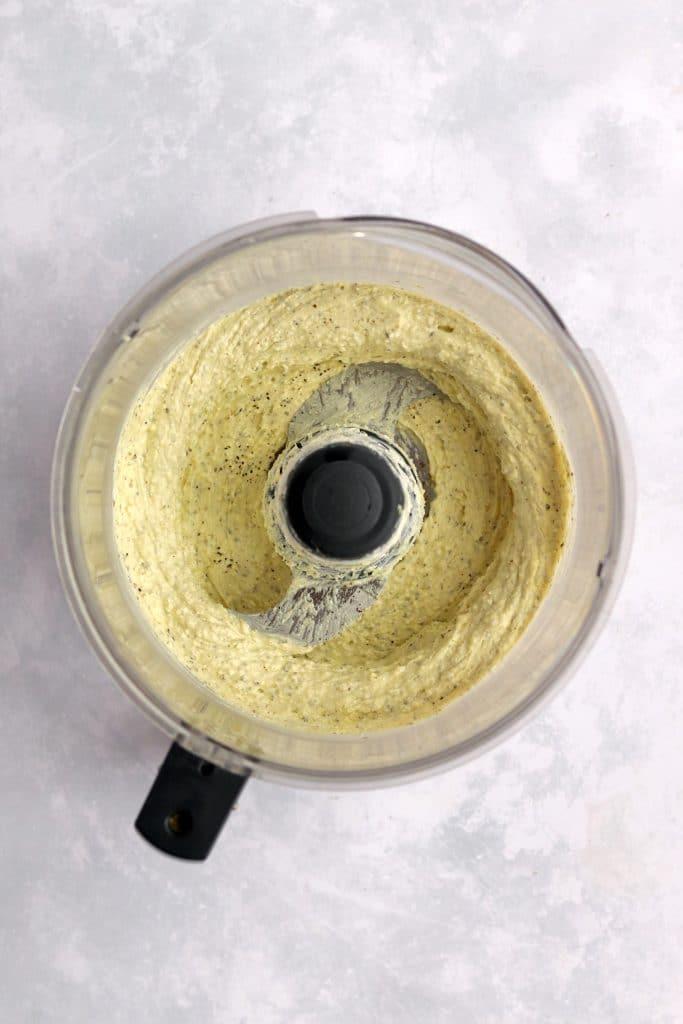 Pesto feta cream cheese filling in a food processor