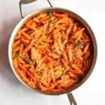 vegan creamy tomato pasta in a large pan