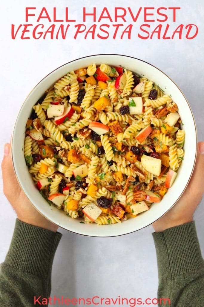 Bowl of fall pasta salad that is vegan with apples, cranberries, and butternut squash