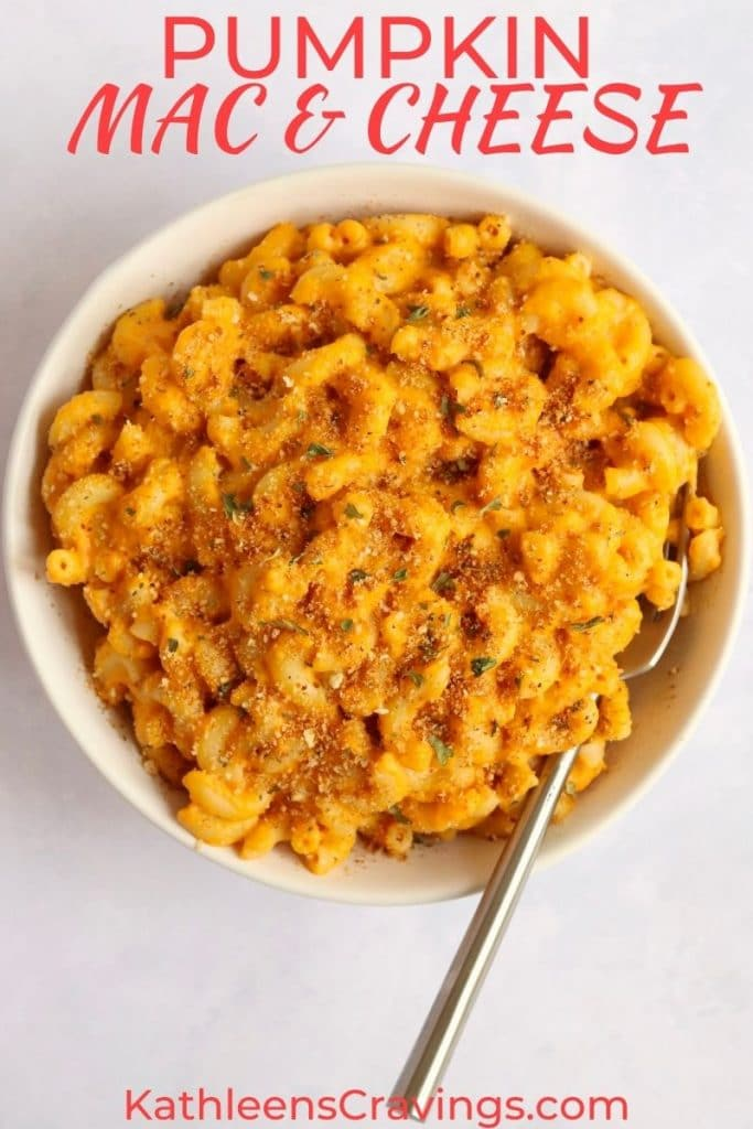 Bowl of creamy pumpkin Mac and cheese with breadcrumbs on top