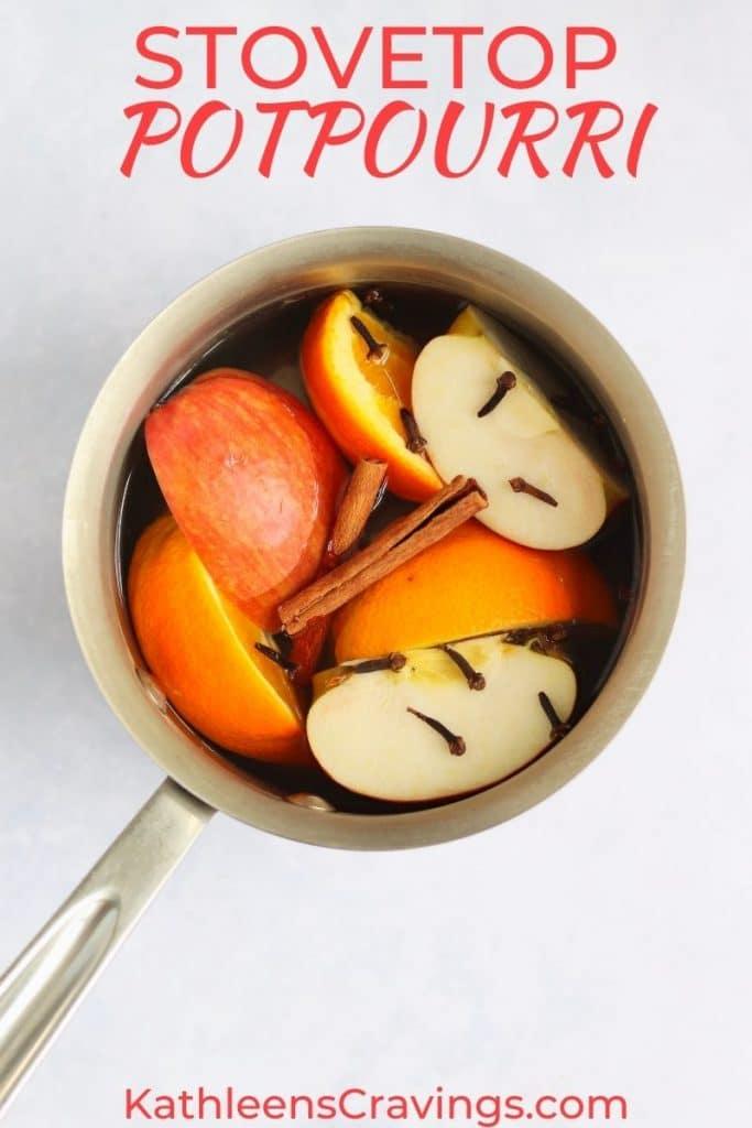 Simmer potpourri in a pot - apples, oranges, cinnamon sticks, and cloves