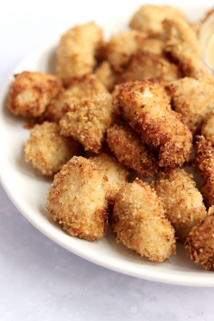 Crispy air fryer chicken nuggets on a plate