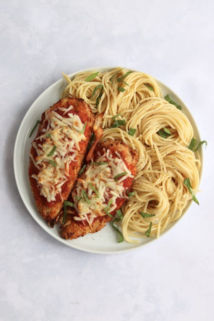 Air fryer chicken parmesan on a plate with pasta