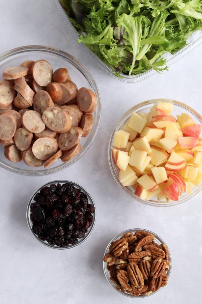 Spring mix, sliced chicken sausage, chopped apples, dried cranberries, and pecans