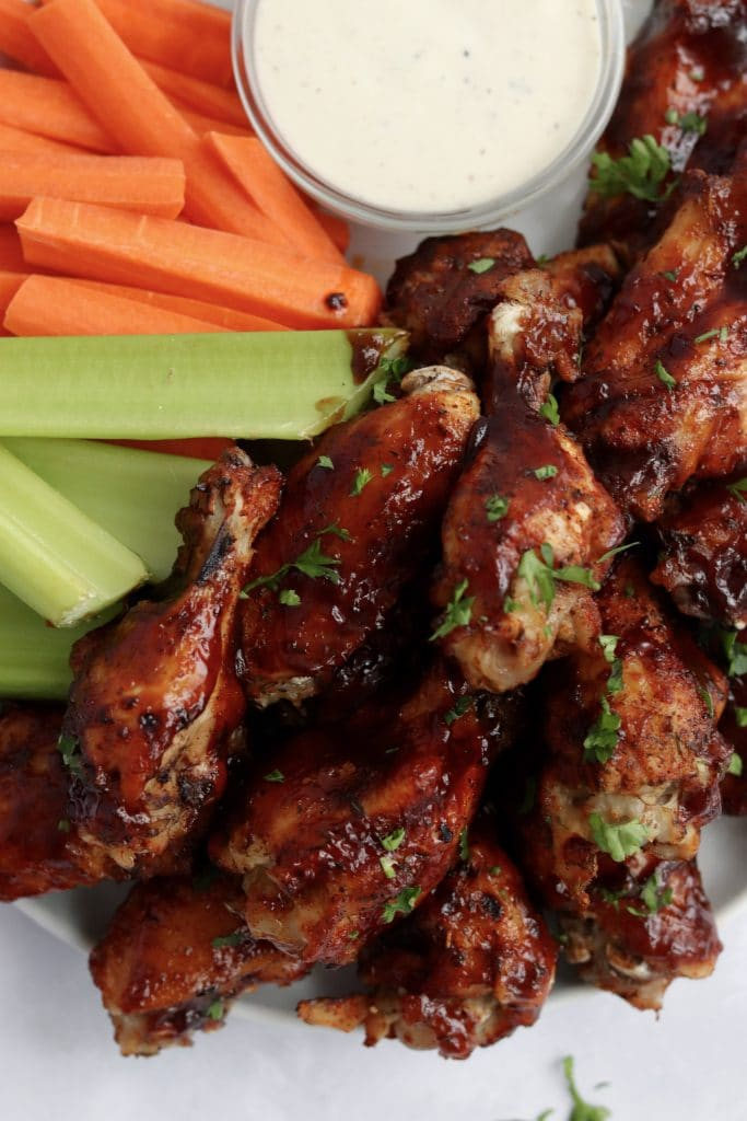 Instant Pot barbecue chicken wings with celery and carrots on a plate