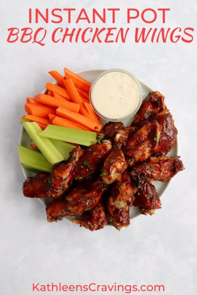 Instant Pot BBQ Chicken wings on a plate with celery and carrots