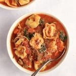 Two bowls of slow cooker sausage tortellini soup