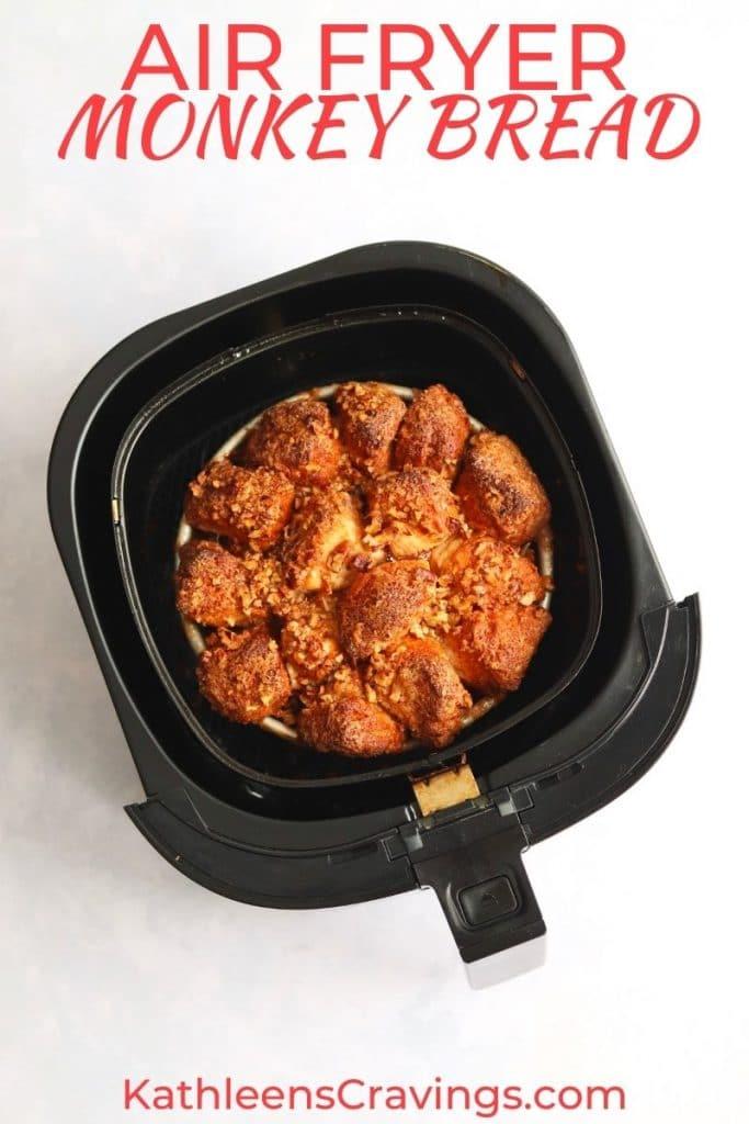 Pecan monkey bread in a cake pan in an air fryer.