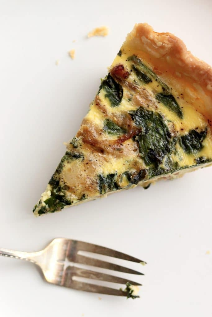 Slice of quiche with a fork