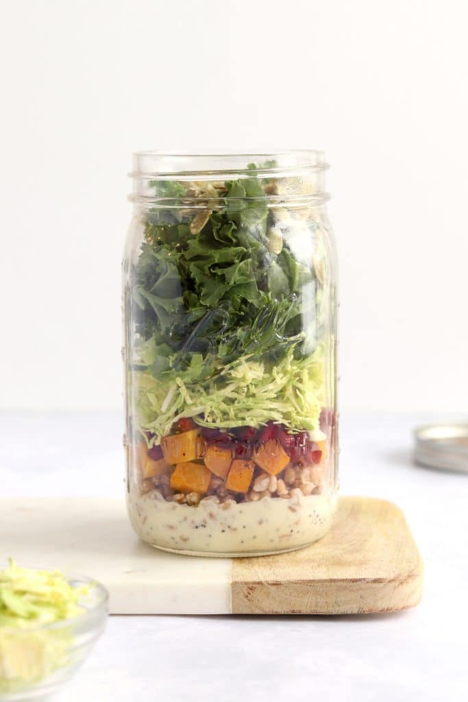 Kale Brussels sprout mason jar salad with roasted butternut squash