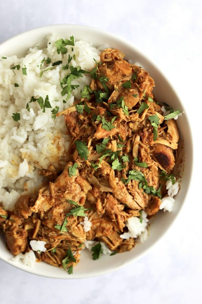 Close up of shredded curry chicken thighs.