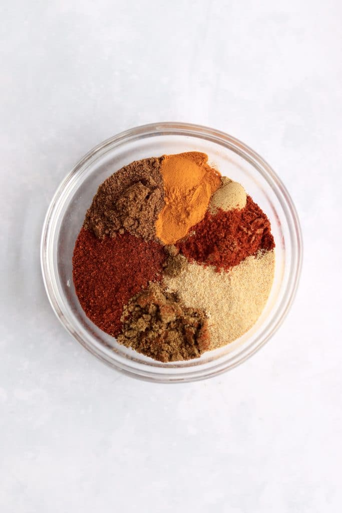 Curry spices in a glass bowl.