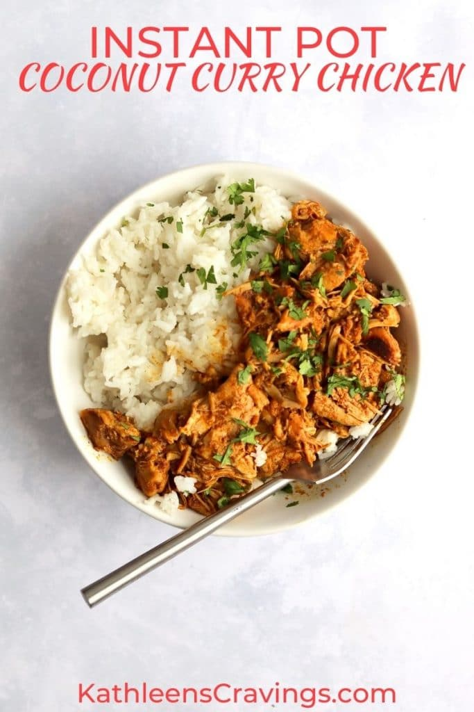 Instant Pot curry chicken in a bowl with rice.