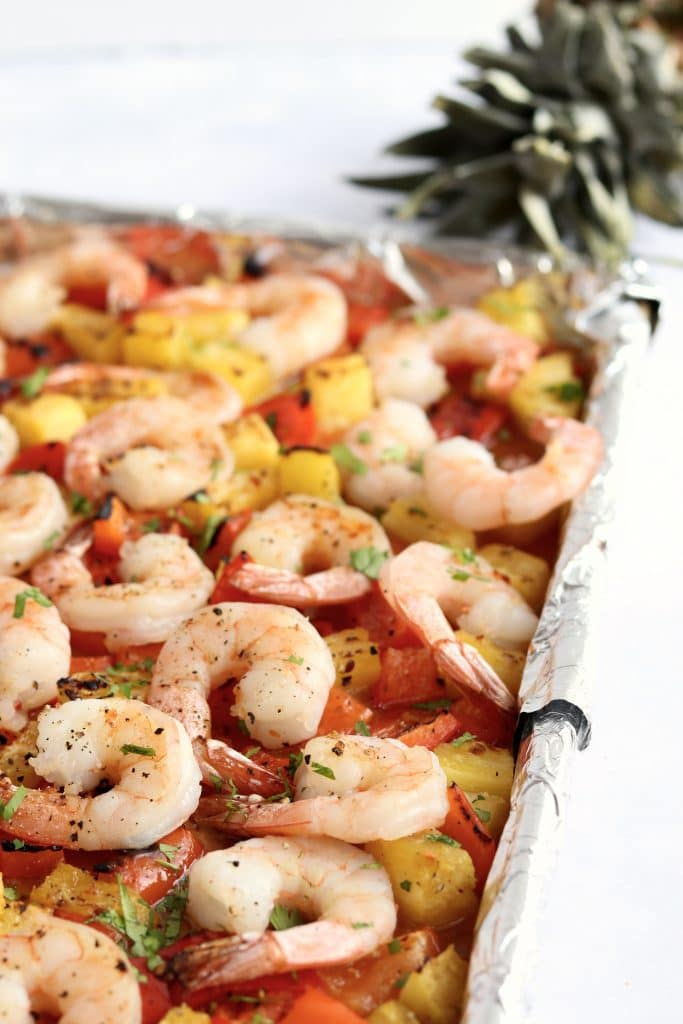 Sheet pan Hawaiian shrimp with pineapple and bell peppers.