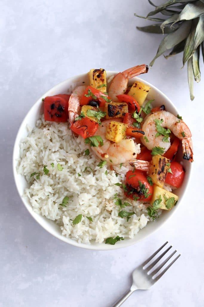 Pineapple shrimp rice bowl with teriyaki sauce.
