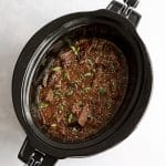 Cooked shredded Korean beef in a slow cooker