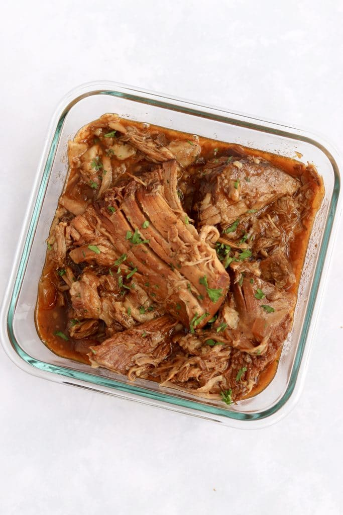Leftover bbq pulled pork in a glass container