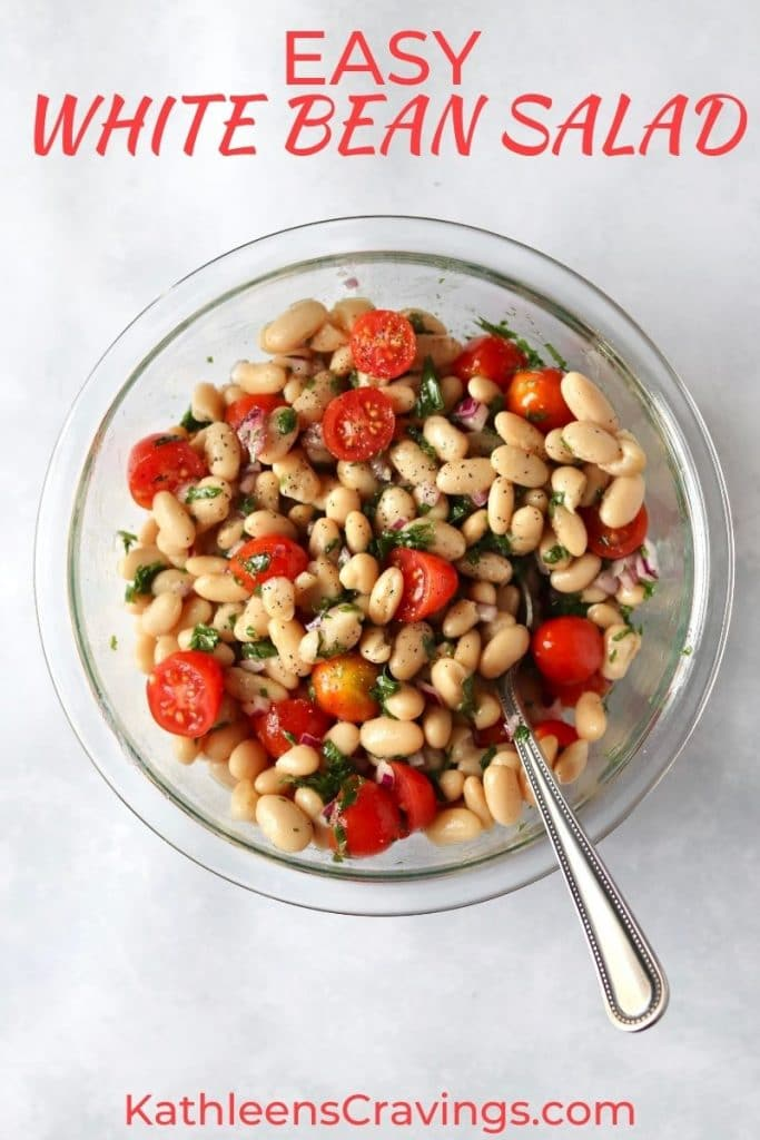 Bowl of white bean salad with tomatoes