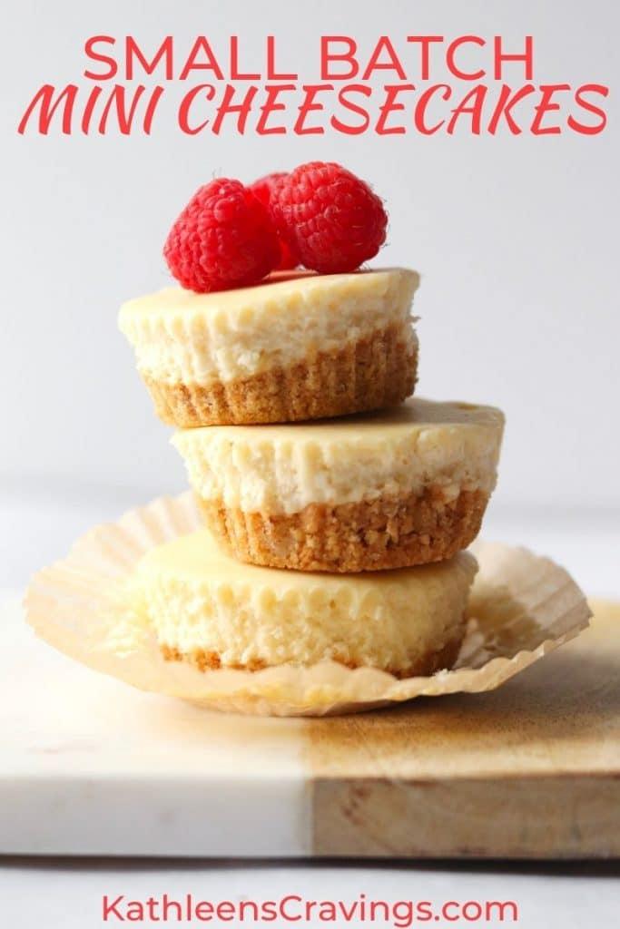 Stack of mini cheesecakes with fresh raspberries