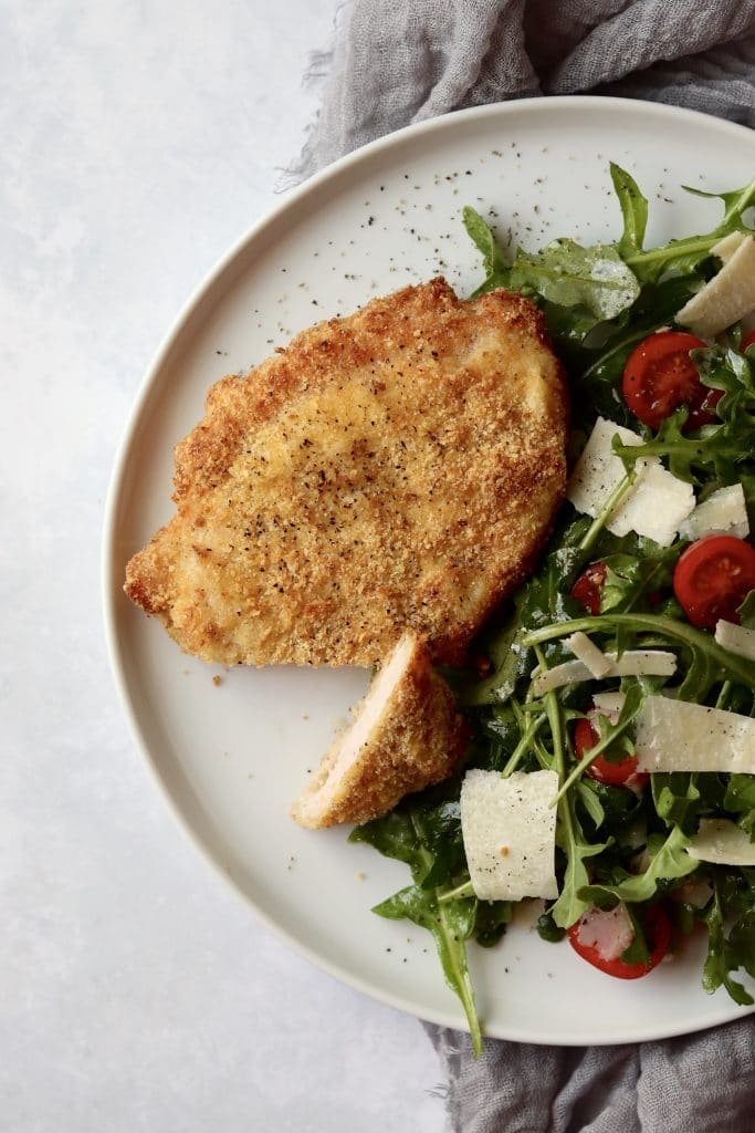 Air fryer pork milanese and salad on a plate