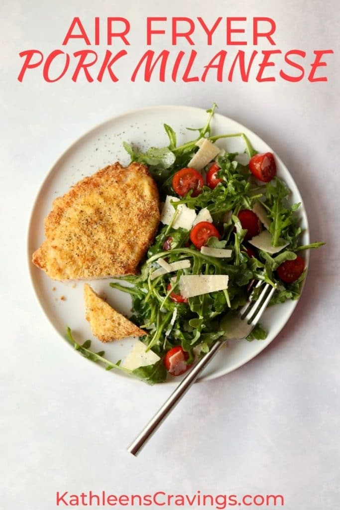 Crispy Pork Milanese with arugula salad on a plate