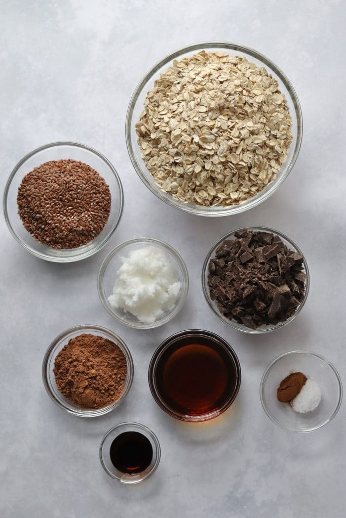 Chocolate granola ingredients in glass bowls