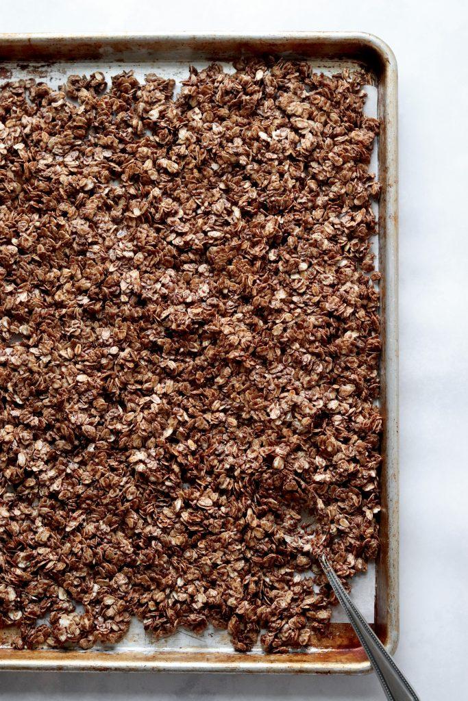 unbaked homemade chocolate granola on sheet pan