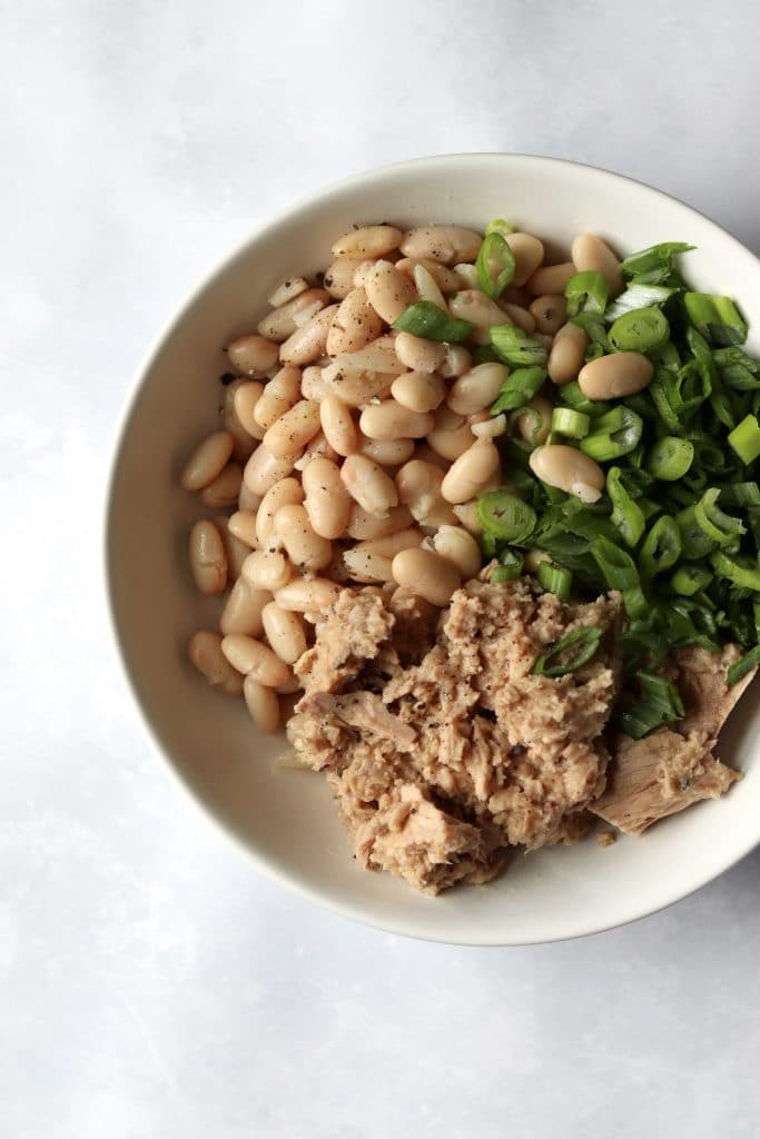 White beans, tuna, and green onions in bowl