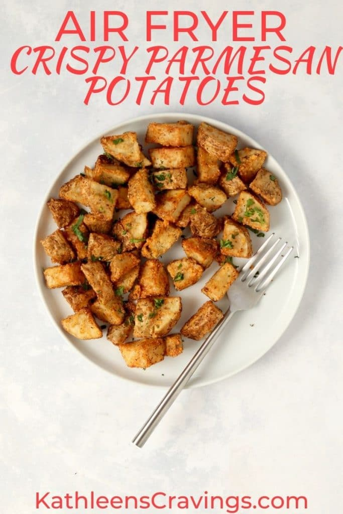 air fryer crispy parmesan potatoes on plate