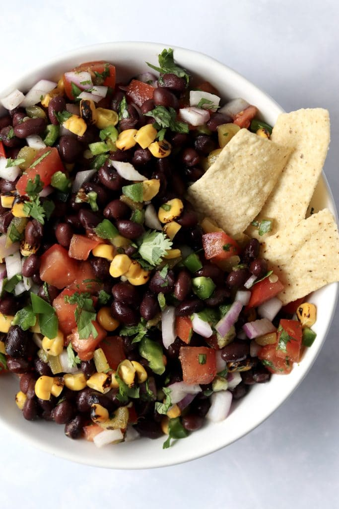 Black bean salsa with corn served with tortilla chips