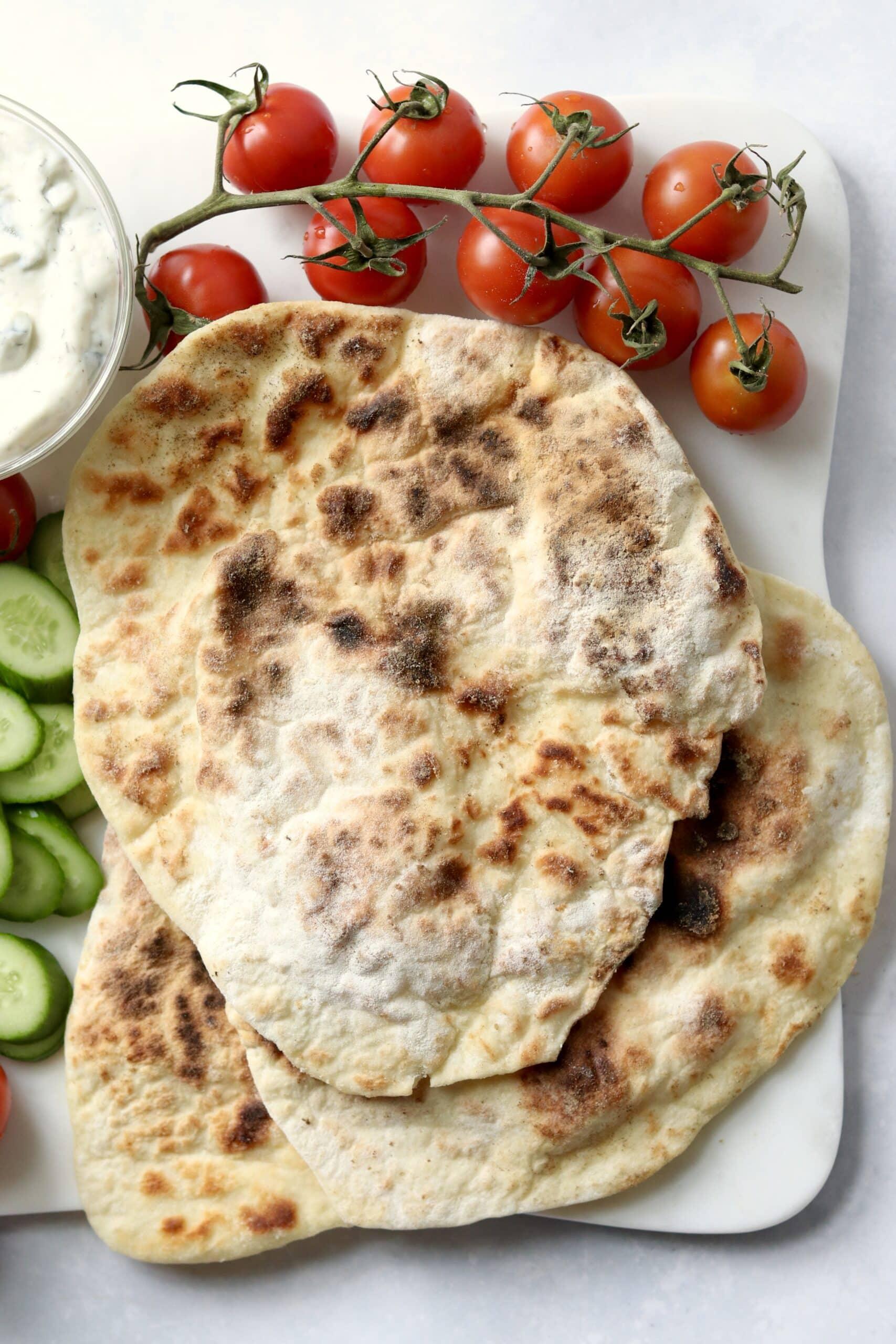 Greek yogurt flatbread with tomatoes and cucumbers
