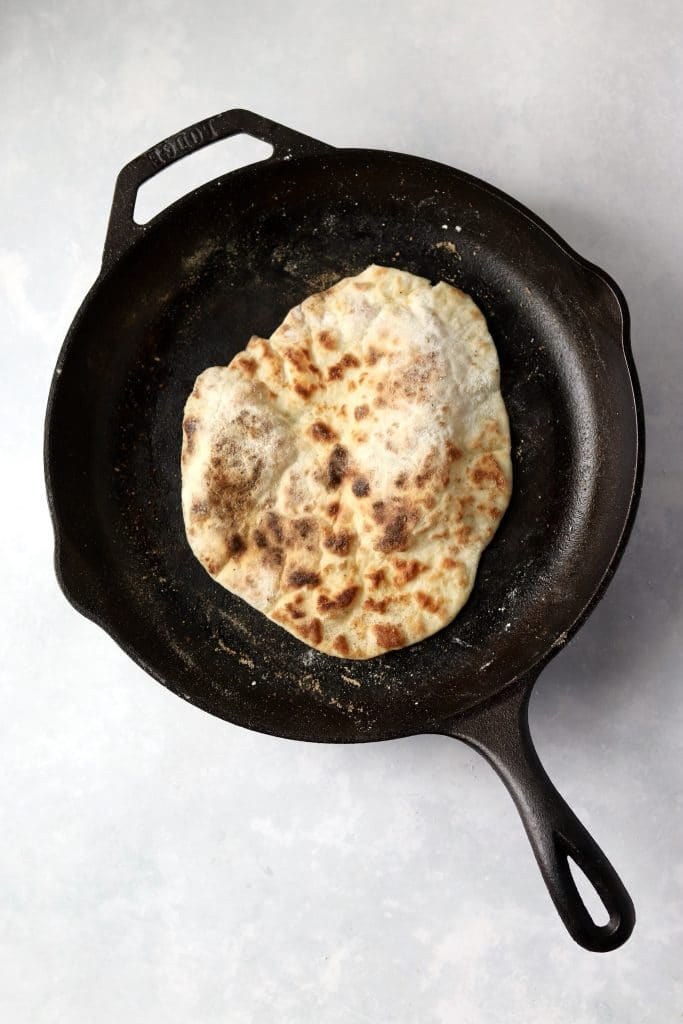 cooked flatbread in skillet