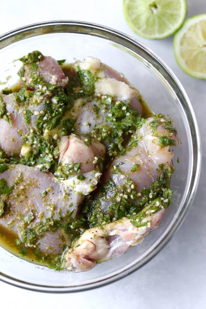 Boneless chicken thighs in a bowl with cilantro lime marinade