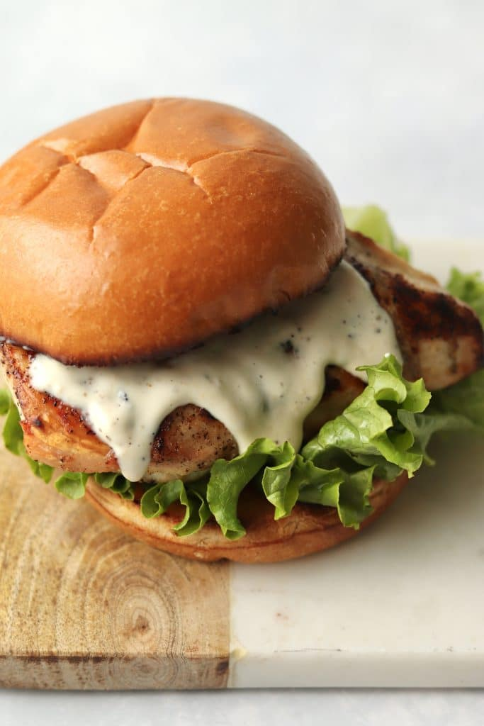 grilled chicken smothered in Caesar salad dressing