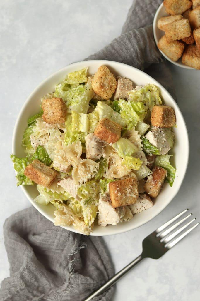 chicken Caesar Pasta Salad in bowl with fork
