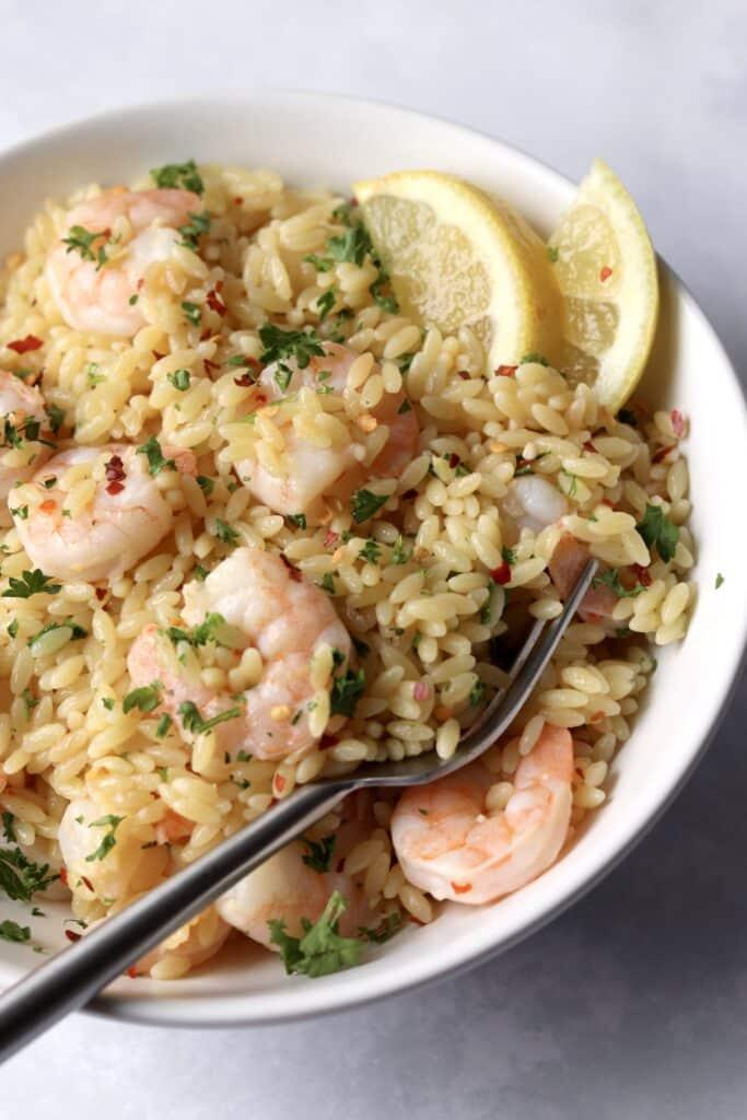 Bowl of one pot lemon butter shrimp orzo