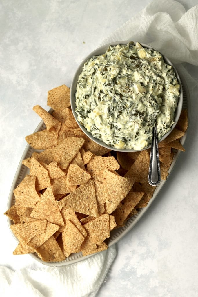Slow cooker spinach artichoke dip with tortilla chips