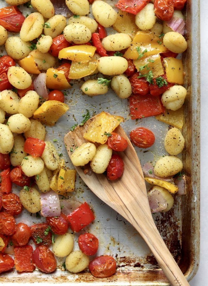wooden spoon with roasted veggies and gnocchi