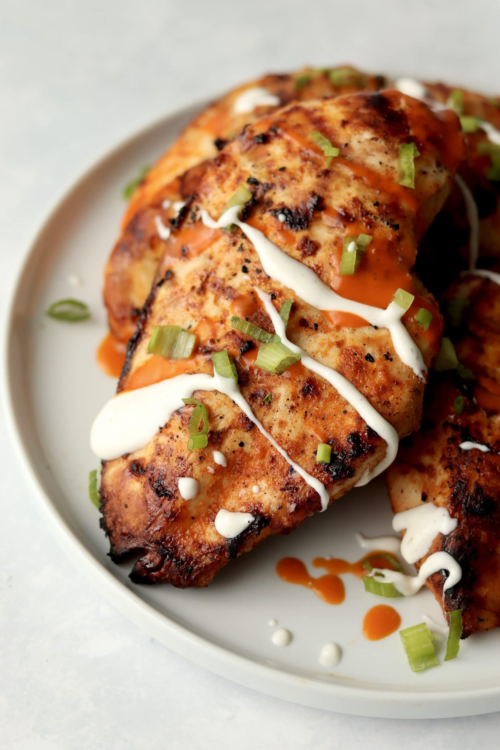 grilled buffalo chicken breasts drizzled with ranch dressing