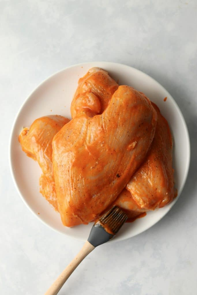 chicken breasts brushed with buffalo sauce