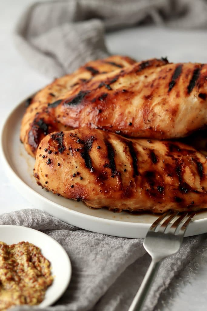 grilled honey mustard chicken breasts on a plate