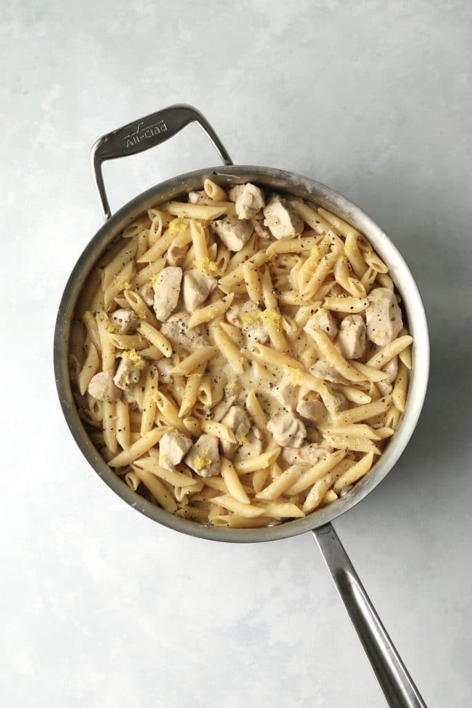 Cooked lemon chicken pasta in a pan