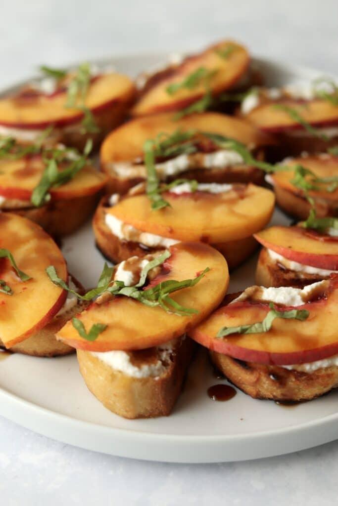 peach ricotta crostini appetizer on plate