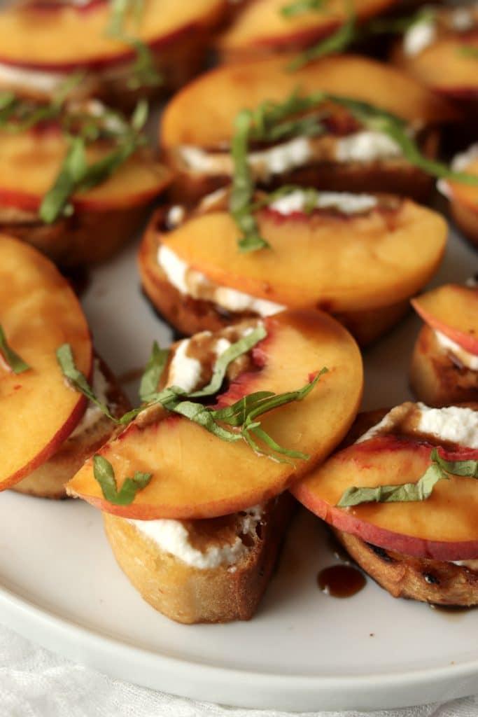 closeup of peach crostini with ricotta
