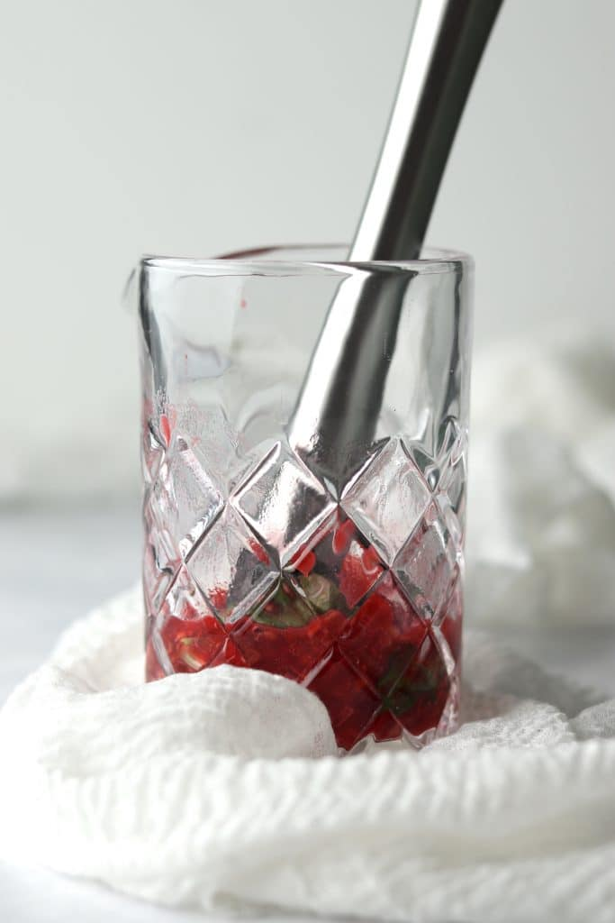 raspberries and basil muddled in pitcher