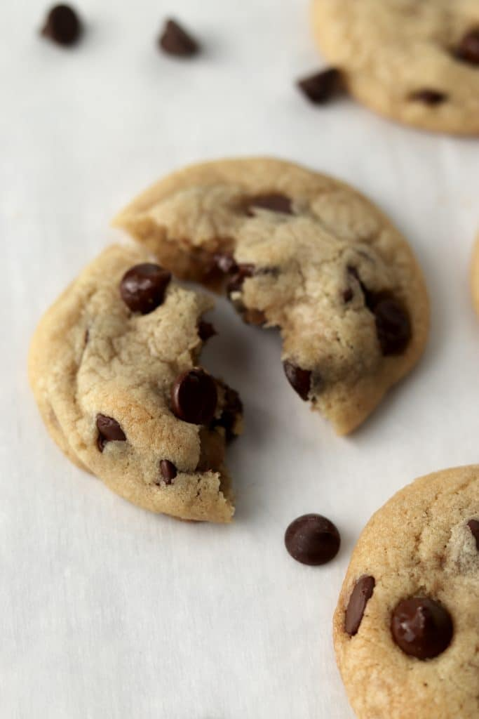 soft chocolate chip cookie torn in half
