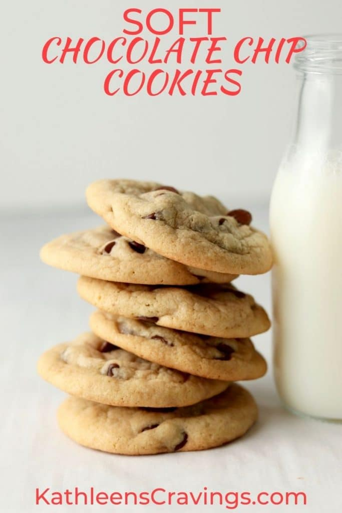 stack of soft chocolate chip cookies with milk