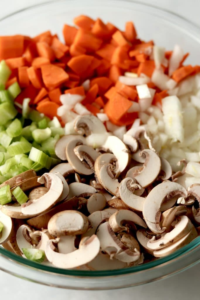 Mushrooms, celery, carrots, and onions in a bowl