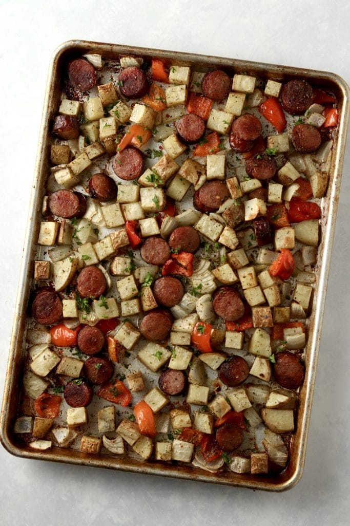 roasted sausage, potatoes, and peppers on sheet pan